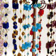 """Were $42.00  12 piece bag of assorted glass beads and gold thread chokers. Each bag has 12 different colors of glass beads. 1"""" chain with lobster clasp"""
